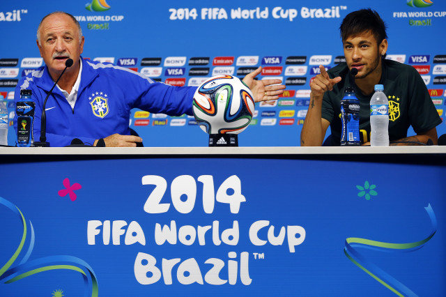 Brazil's national soccer team coach Scolari gestures towards Neymar as they address reporters before their team's final practice in Sao Paulo