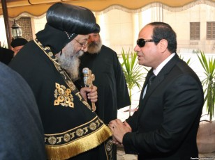 Egyptian President Abdel-Fattah el-Sissi, right, offers his condolences to Egypt's Coptic Pope Tawadros II at Saint-Mark's Coptic Cathedral in Cairo's al-Abbassiya district, Feb. 16, 2015.