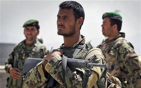 kabul afghanistan 2011. An Afghan soldier cradles his