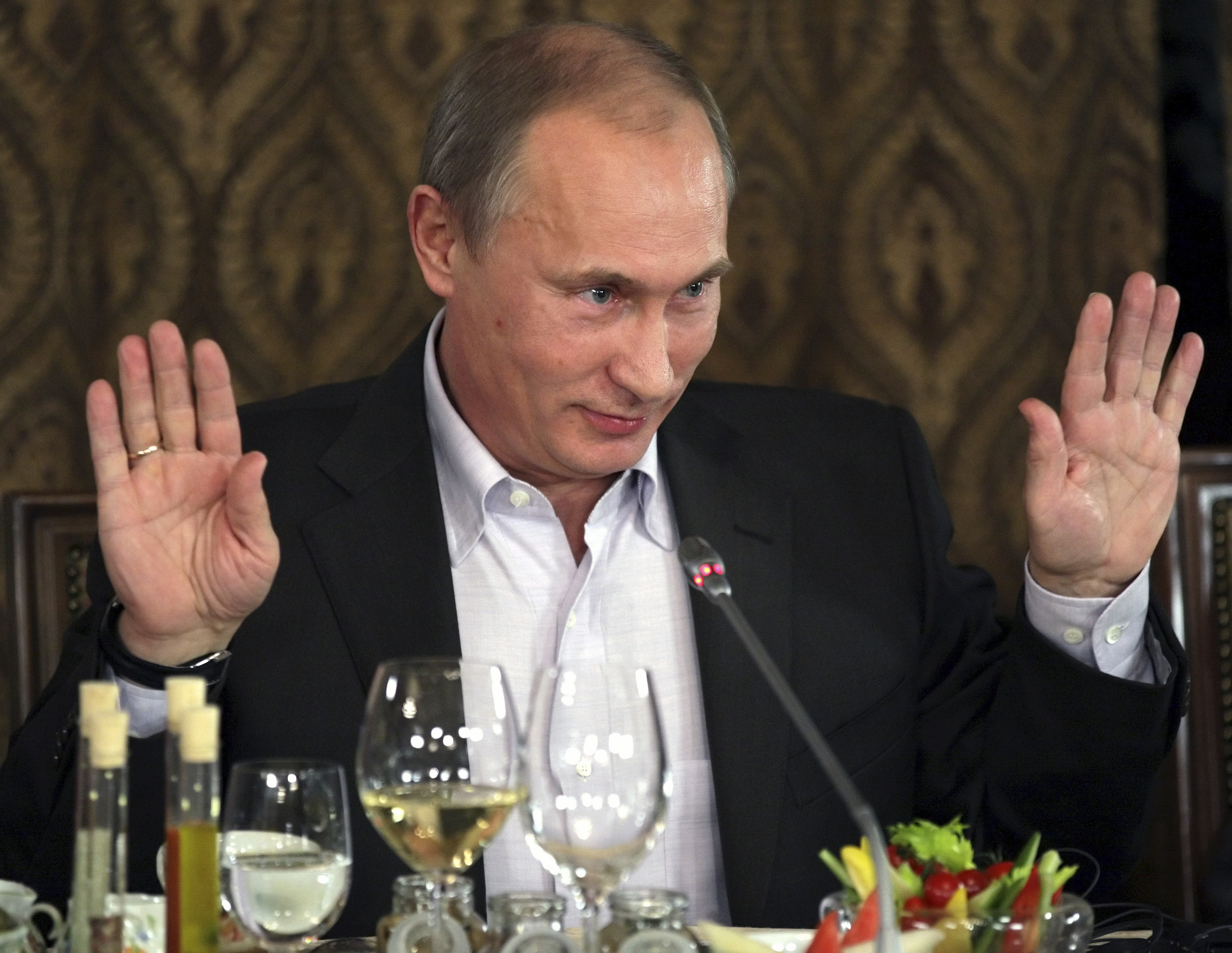Russia S Pm Putin Gestures As He Meets With Members Of The