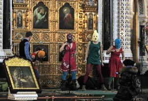 Members of radical feminist group Pussy Riot try to perform their 'punk prayer' to save the nation from Vladimir Putin at Russia's largest Orthodox Cathedral, Christ the Savior, in Moscow on Feb. 21. AP Photo: Sergey Ponomarev