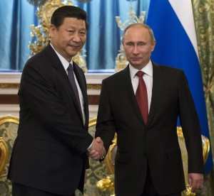 Chinese President Xi is happy to let Russian President Vladimir Putin take the lead on police work in Central Asia. Russia is bolstering Tajikistan's southern border in preparation of the pullout of NATO troops from Tajikistan: Photo: AP/Alexander Zemlianichenko