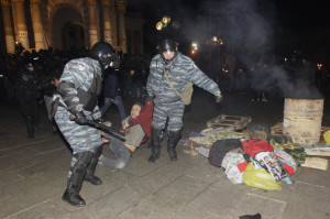 Video clips went viral of riot police clubbing, gassing and kicking demonstrators under the cover of darkness. Photo: AP/Sergei Chuzavkov