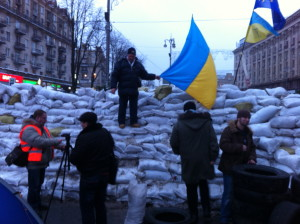 The pro-Europe Maidan has become a huge magnet for Kyiv residents. Here a man poses on barricade that blocks Kreschatyk,  the capital's central avenue. VOA Photo: James Brooke