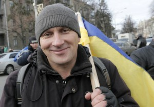 Leonid from Lviv traveled halfway across Ukraine to demonstrate in favor of Ukraine moving closer to the European Union. AP Photo: Efrem Lukatsky