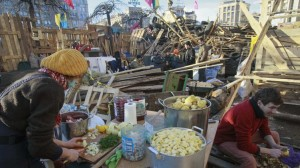 Food donations flow steadily into the Maidan protest city, enough to feed the thousands who come and go daily. Photo: Reuters/Gleb Garanich