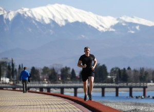 It may be healthy, but it is not cold. Man jogs on coast near Olympic Park. Photo: Reuters/Shamil Zhurnatov