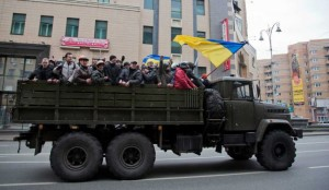 Russia's nightmare: Rebels ride atop a confiscated military truck in central Kyiv on Feb. 22. Will they next head East to confront Yanukovych supporters? AP Photo: Darko Bandic