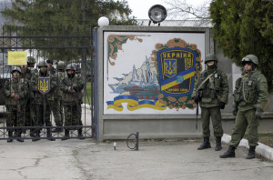Ukrainian soldiers wait inside the gates of their base Perevolnoye, Crimea, which was surrounded Sunday by 400 Russian soldiers and four Russian armored personnel carriers. Photo:AP/Darko Vojinovic