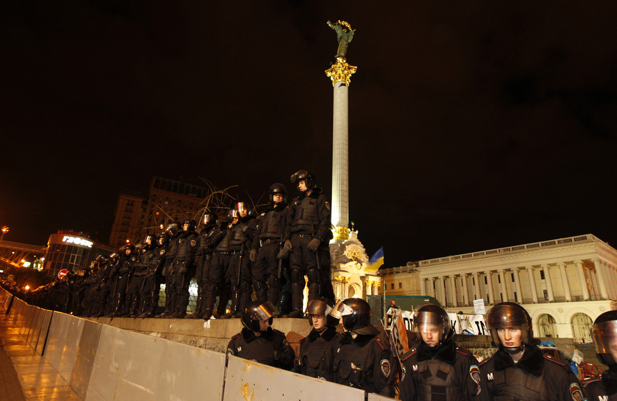 Riot police stand guard at Independence Square during a protest in Kiev