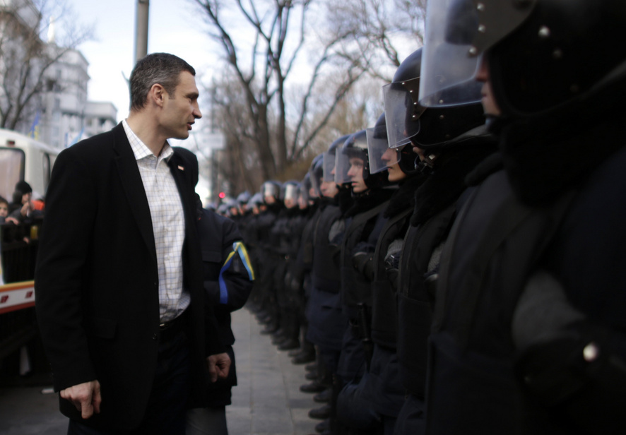 Klitschko walks past police outside parliament in Kiev