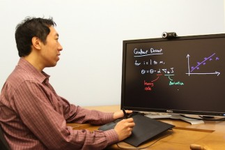 Computer Science professor Andrew Ng uses tablet-recording technology he developed to instantly display notes for his interactive video lecture. (Photo: Stanford University/Morgan Quigley)