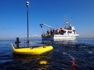The team of Scripps Oceanography scientists will use a surfboard-sized Wave Glider from Liquid Robotics to relay real-time seismic data. (Photo: Liquid Robotics)