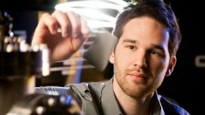 Wake Forest graduate student Corey Hewitt holds a piece of Power Felt developed in the Center for Nanotechnology and Molecular Materials. (Photo: Wake Forest University)