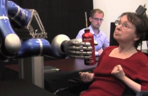 In a clinical trial, a woman used the BrainGate system to mentally control a robotic arm and reach for a drink.  (Photo: The BrainGate Collaboration)