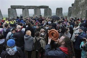 Crowd gathers for 2012 Summer Solstice at Stonehenge (AP Photo/Lefteris Pitarakis)