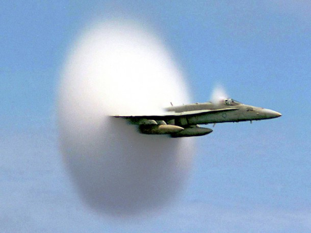 A cloud forms as this F/A-18 Hornet aircraft speeds up to supersonic speed. Aircraft flying this fast push air up to the very limits of its speed, forming what's called a bow shock in front of them. (Photo: Ensign John Gay, USS Constellation, U.S. Navy)
