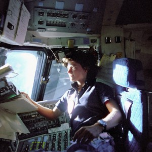 In this June 1983 photo released by NASA, astronaut Sally Ride, a specialist on shuttle mission STS-7, monitors control panels from the pilot's chair on the shuttle Challenger flight deck. (Photo: AP Photo/NASA, File)