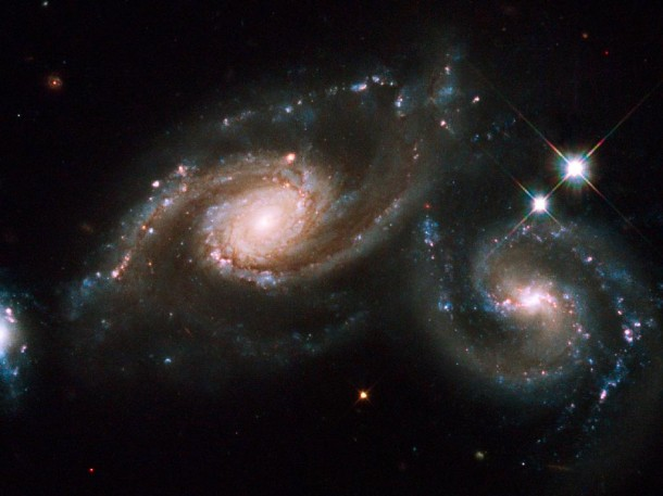 From the Hubble Space Telescope - Two spiral galaxies are squaring off in the constellation of Virgo. When two galaxies collide, the stars that compose them usually do not. This is because galaxies are mostly empty space. (Photo: NASA, ESA, M. Livio (STScI) and the Hubble Heritage Team (STScI/AURA))