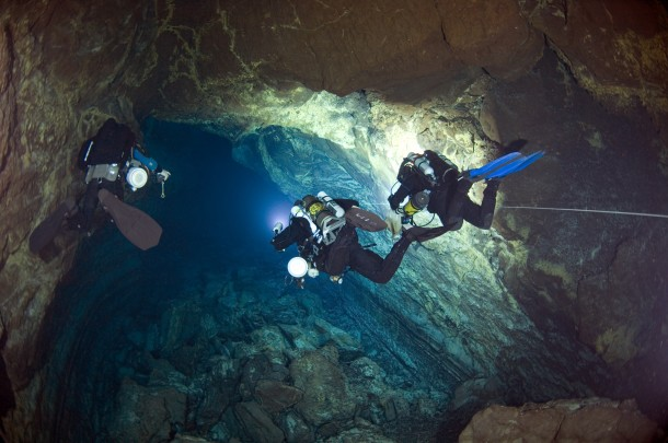 "Cave divers exploring a submarine lava tube cave in the Canary Islands for a National Science Foundation-supported expedition,""Survey of Anchialine Cave Fauna of the Bahama Islands"" (Photo: Jill Heinerth/NSF)"