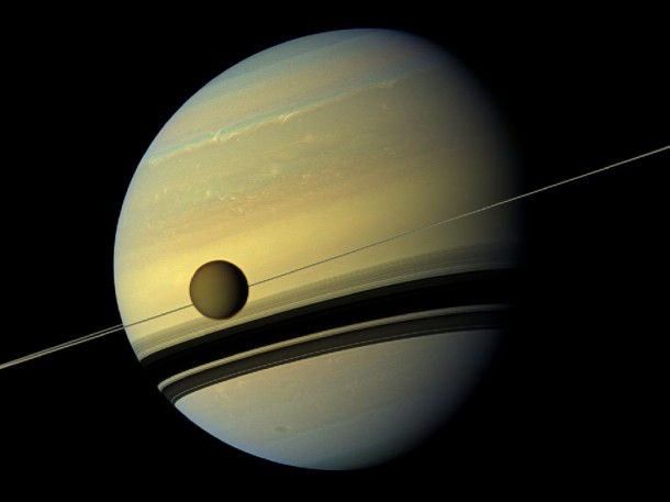 A mosaic of images of Saturn and its moon, Titan, taken by NASA's Cassini spacecraft. Seasons have changed on Saturn, the azure blue in the planet's northern hemisphere is now fading while the southern hemisphere is now taking on a bluish hue. Scientists say these changes are likely due to the reduced intensity of ultraviolet light and the haze it produces in the southern hemisphere as winter approaches, and the increasing intensity of ultraviolet light and haze production in the northern hemisphere as summer approaches. (Photo: NASA)