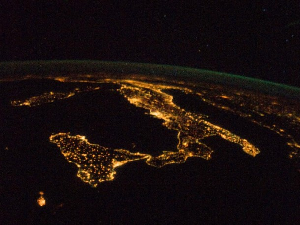 "The famous ""boot"" shape of Italy is illuminated by the country's night lights.  Photo taken aboard the International Space Station. You can also see Sardinia and Corsica are just above left center of the photo, and Sicily is at lower left. (Photo: NASA)"
