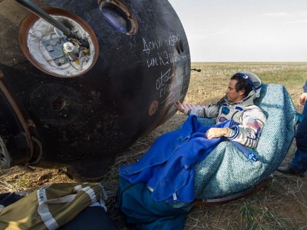 NASA Flight Engineer Joe Acaba signs the side of his Soyuz TMA-04M spacecraft that brought him and his crew mates back to Earth on September 17, 2012.  Acaba, along with Gennady Padalka and Sergei Revin of Russia returned from four months on board the International Space Station where they served as members of the Expedition 31 and 32 crews. (Photo: NASA/Carla Cioffi)