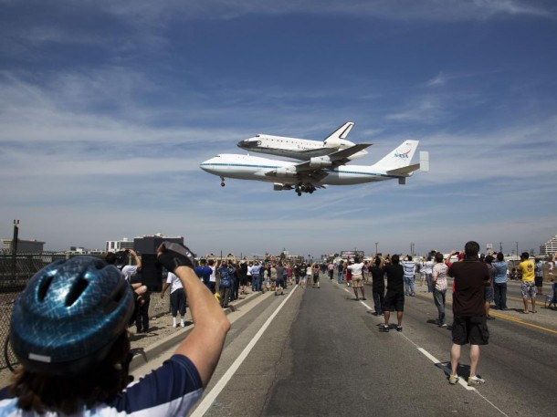 A shot of the space shuttle Endeavour, atop the Shuttle Carrier Aircraft, when it recently landed  at the Los Angeles International Airport.  The flight marked the final scheduled ferry flight of the Space Shuttle Program.  The shuttle will be placed on public display at the California Science Center. (Photo: NASA/Matt Hedges)