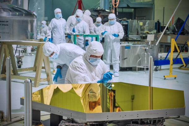Technicians and scientists, in the clean room at NASA's Goddard Space Flight Center in Greenbelt, Md., check out one of the first two flight mirrors that will be used on the new Webb Space Telescope. (Photo: NASA/Chris Gunn)