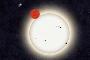The newly discovered planet PH1 is depicted in this artist's rendition transiting the larger of the its two host stars. Left of the planet, off in the distance, is a second pair of stars that orbit PH1. (Image: Haven Giguere/Yale)
