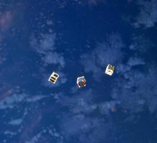 No, these aren't miniature UFOs but are tiny cube shaped satellites that were released into space from the airlock of the International Space Station's Kibo laboratory. One of these little CubeSats was developed by a group of student interns from San Jose State University and will be used for a communications experiment (Photo: NASA)