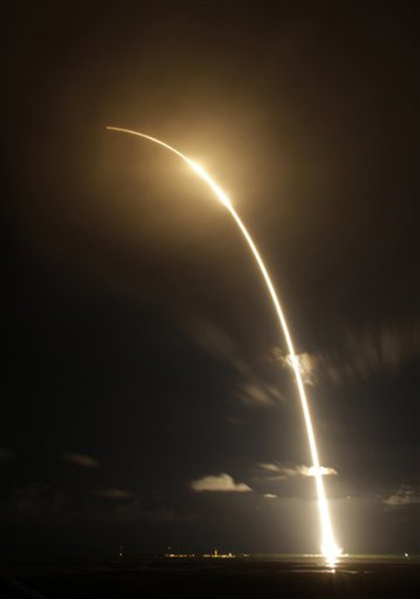 This time exposure photo shows the Falcon 9 SpaceX rocket lifting off from the Cape Canaveral Air Force Station in Cape Canaveral, Florida. The rocket with it's Dragon space capsule payload just made its first commercial delivery of supplies to the International Space Station. (Photo: AP)