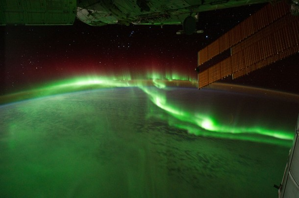 "Astronauts on the International Space Station recently used a digital camera to capture several hundred photographs of the Aurora Australis, or the ""southern lights"". Solar panels and other sections of the ISS fill some of the upper right side of the photograph.  (Photo: NASA)"