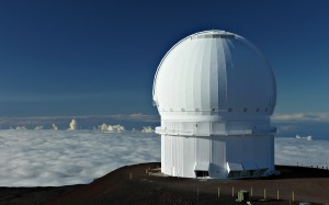 The dome of the Canada-France-Hawaii Telescope (CFHT) is a world class 3.6-meter telescope that sits above the clouds atop Hawaii's Mauna Kea, a dormant volcano. (Photo: © J.-C. Cuillandre (CFHT))