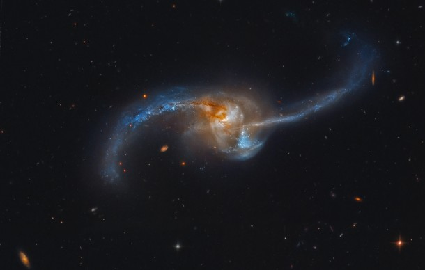 Two galaxies becoming one - this is a Hubble photo of NGC 2623 which is really two galaxies that are in the final stages of a titanic galaxy merger some 300 million light-years away.  (Photo: NASA)