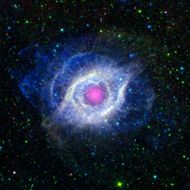 "In a combined image from NASA's Spitzer Space Telescope, the Galaxy Evolution Explorer (GALEX) and the Wide-field Infrared Survey Explorer (WISE), this is the Helix Nebula, which has also been called the ""Eye of God.""  At the nebula's heart is a dying star.  In its death throes, the star's outer layers unravel into space and is set aglow by powerful ultraviolet radiation that's being pumped out by it's hot stellar core. (Photo: NASA)"