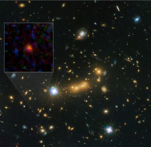 Composite image of the newly discovered galaxy - MACS0647-JD. The inset at left shows a close-up of the young dwarf galaxy. (Photo: NASA, ESA, & M. Postman and D. Coe (STScI) and CLASH Team)