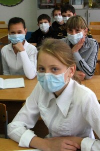 Students in Kazakhstan wear surgical masks to help prevent the spread of flu during the 2009 swine flu outbreak.  An influenza forecasting system such the one Jeff Shaman and colleagues are developing could help health officials better plan for upcoming outbreaks. (Photo: Nikolay Olkhovoy via Wikmedia Commons)