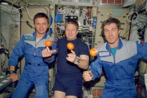 First humans aboard the International Space Station 11/2000 - the Expedition One crew about to enjoy a snack. From the left, are cosmonaut Yuri P. Gidzenko, Soyuz commander; astronaut William M. Shepherd, mission commander; and cosmonaut Sergei K. Krikalev, flight engineer. (Photo: NASA)