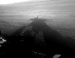 A shadow self-portrait taken by NASA''s Opportunity rover on the Martian surface. The solar-powered spacecraft has been exploring a huge crater in the Martian southern hemisphere and has detected what appear to be clay minerals. (AP Photo NASA)