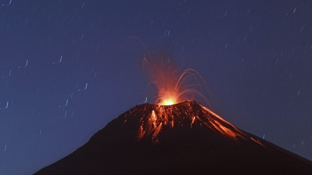This photo, taken recently at a slow shutter speed shows lava flowing down central Ecuador's Tungurahua volcano.(AP Photo/Dolores Ochoa)