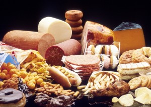 A display of high fat foods such as cheeses, chocolates, lunch meat, french fries, pastries, doughnuts, etc. (Photo: US National Cancer Institute)