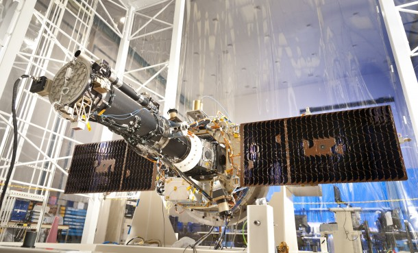 With its solar panels deployed, this is the spacecraft that will be used for NASA's Interface Region Imaging Spectrograph (IRIS) mission as seen in a clean room at the Lockheed Martin Space Systems Sunnyvale, Calif. The spacecraft is scheduled to be launched this April. (Photo: Lockheed Martin)