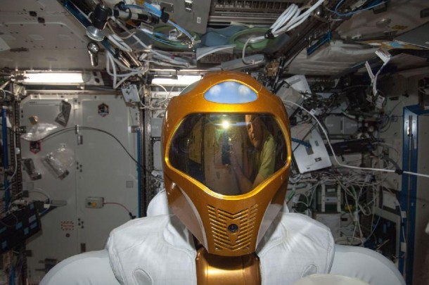 Here's A close-up photo of Robonaut 2 - R2, the first dexterous humanoid robot in space that was taken inside the International Space Station's Destiny laboratory. By the way you can see the reflections of NASA astronaut Kevin Ford on R2's helmet visor. (Photo: NASA)