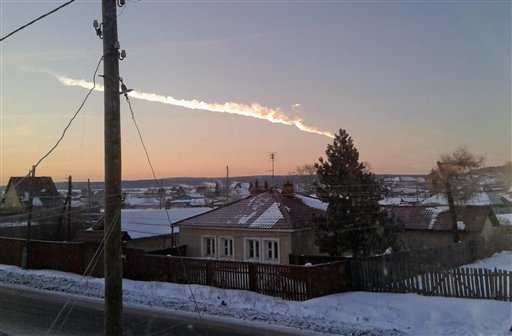 A meteorite contrail is seen over a village of Bolshoe Sidelnikovo 50 km of Chelyabinsk on Friday, Feb. 15, 2013. (Photo: AP/Nadezhda Luchinina, E1.ru)