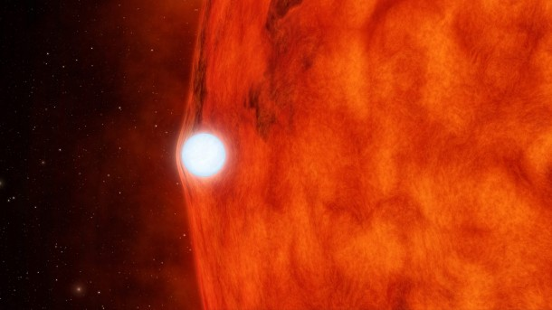 Artist's concept of a dense, dead star called a white dwarf crossing in front of a small, red star. The white dwarf's gravity is so great it bends and magnifies light from the red star. NASA's Kepler space telescope recently observed this effect in a double-star system called KOI-256 (NASA/JPL-Caltech)