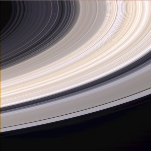 Image of Saturn's rings taken from the Cassini spacecraft show that different rings have slightly different colors. The ring particles are mostly light water-ice. (NASA)