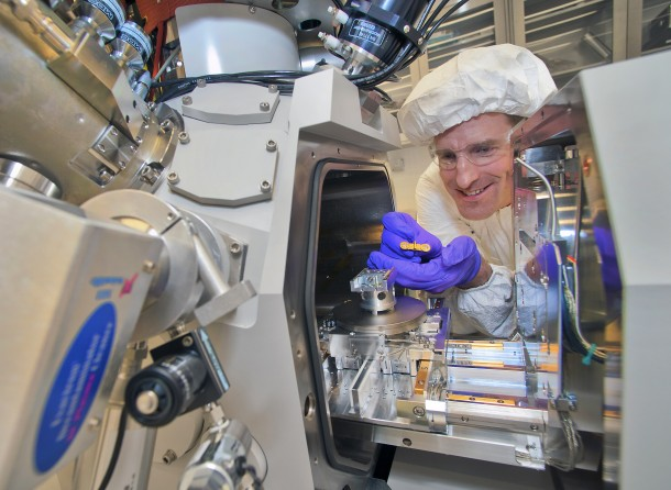 Engineer uses a focused-ion beam instrument to prepare samples of organic solar cell material for imaging under an electron microscope. (Brookhaven National Laboratory)