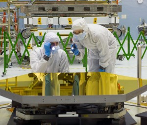 Technicians inspect primary mirror segments that will be used on the James Webb Space Telescope. (NASA/Chris Gunn)
