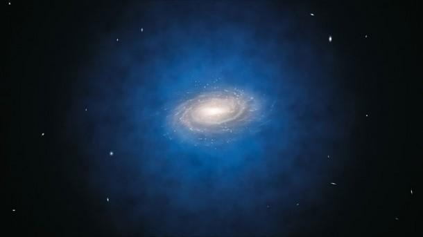 An artist's impression shows the Milky Way galaxy. The blue halo of material surrounding the galaxy indicates the expected distribution of the mysterious dark matter. (ESO/Calçada)